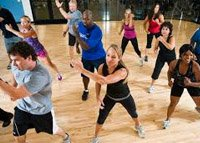 Participants in a keep fit class in a public hall